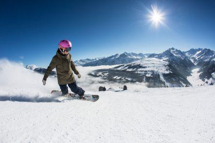 Snowboarderin Gerlos Sonne Berge