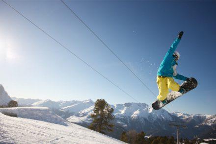 Snowboard Grab Sonne Berge