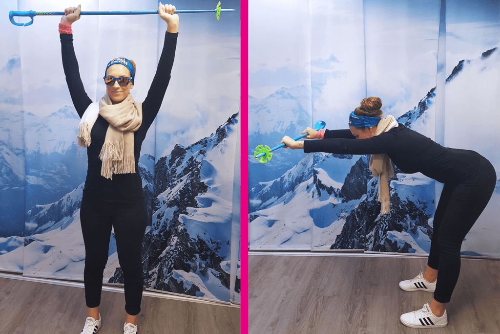 Frau geht in die Vorbeuge mit einem Skistock